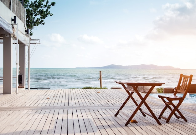 Relaxing on resort with outdoor seat on beach Premium Photo