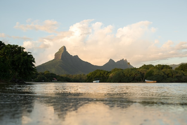 Rempart and mamelles peaks, from tamarin bay where the indian ocean meets the river, tamarin, black river district, mauritius Premium Photo