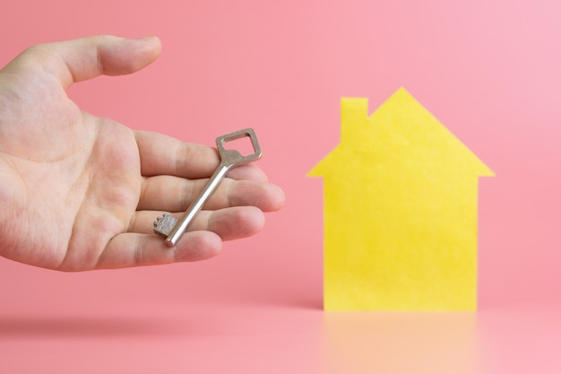 Rental housing concept, hand with key - symbol of buying Premium Photo