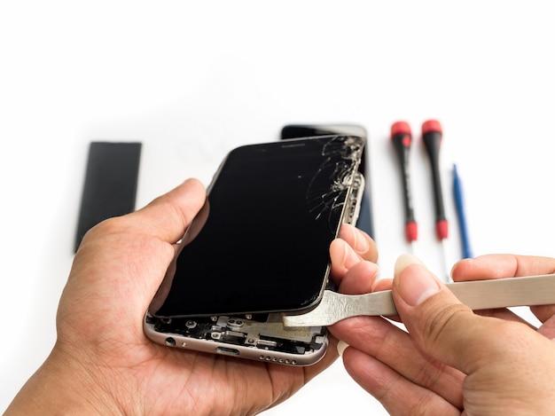 Repair broken smartphone on white background Premium Photo