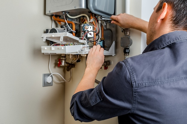 Repair of a gas boiler. Premium Photo
