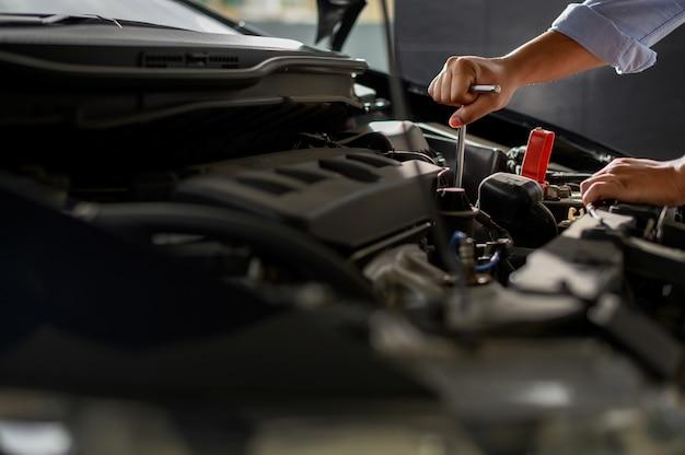 Repair service car auto mechanic working in garage car Premium Photo