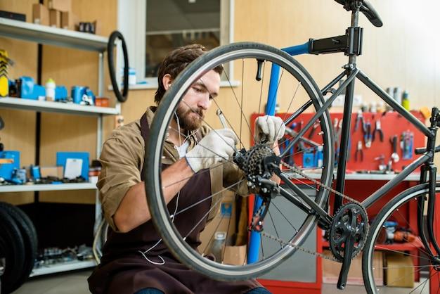 Repairing bicycle wheel Free Photo
