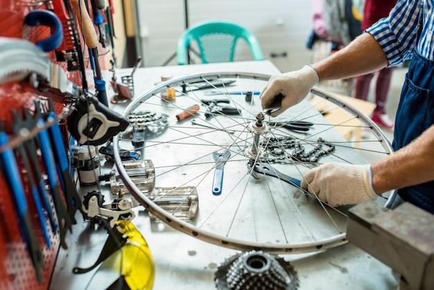 Repairing wheel of cycle Free Photo