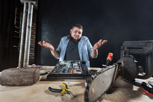 Repairman fixing problem with electronic components of computer hardware. Premium Photo