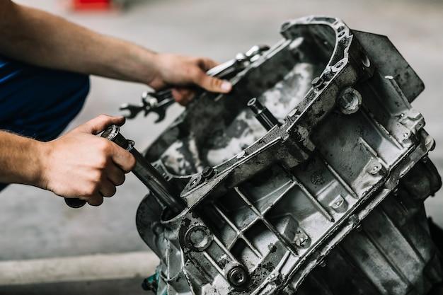 Repairmen with wrenches fixing car engine Premium Photo