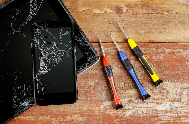 Repairs the tablet and smart phone top view of working. Premium Photo