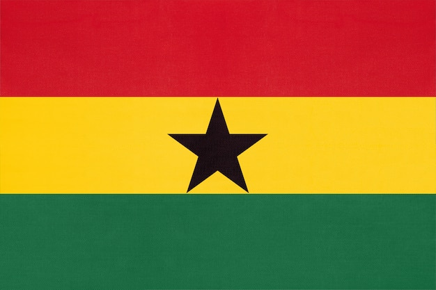 Republic of ghana national fabric flag, textile background. symbol of world african country. Premium Photo