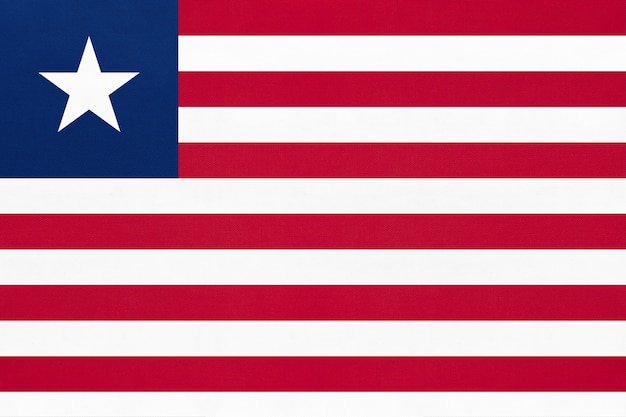Republic liberia national fabric flag textile background. symbol of world african country. Premium Photo