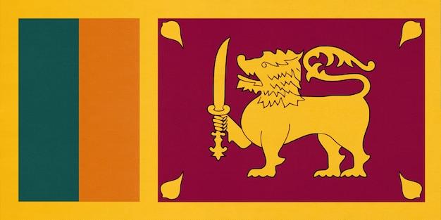 Republic of sri lanka national fabric flag, textile background. symbol of asian world country. Premium Photo