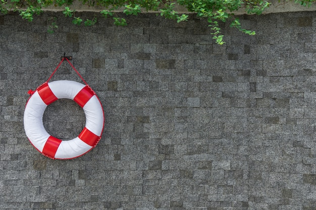Rescue buoy hanging on the wall with copy space Premium Photo