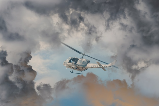 A rescue helicopter races against an oncoming storm severe weather, modern attack helicopter with with weapons Premium Photo