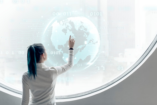 Researcher spinning a globe on a round screen Free Photo
