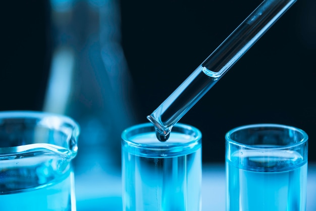 Researcher with glass laboratory chemical test tubes Premium Photo
