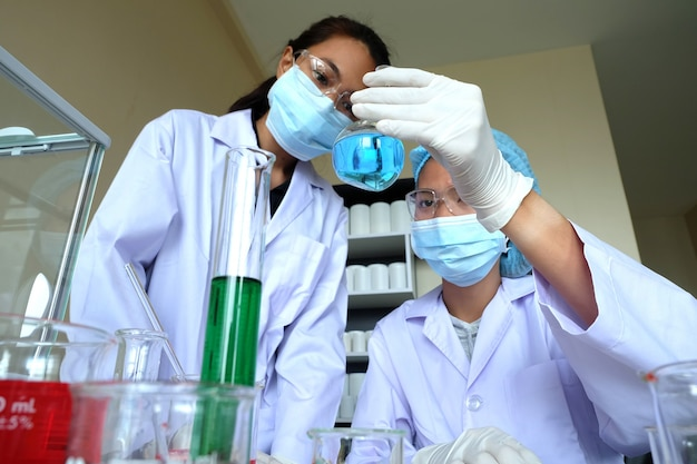 Researching in laboratory Free Photo