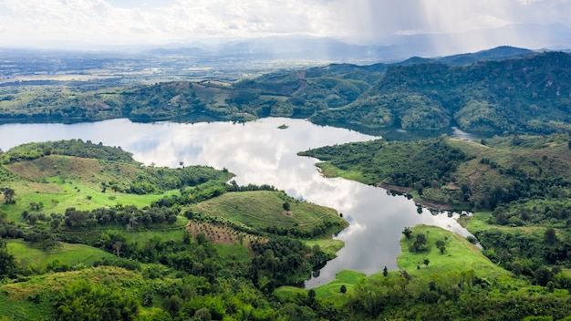 Reservoir in the valley in the rain season aerial top view from drone Premium Photo