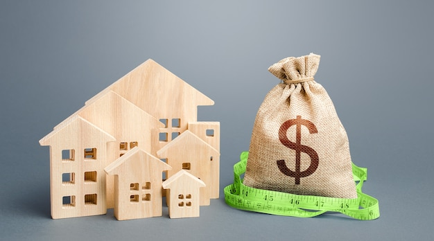 Residential houses and a dollar money bag. property real estate valuation. Premium Photo