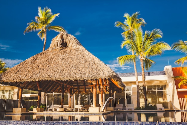A resort swimming pool at tropical hotel background Premium Photo