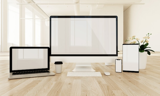 Responsive devices on the floor with white screen, Premium Photo