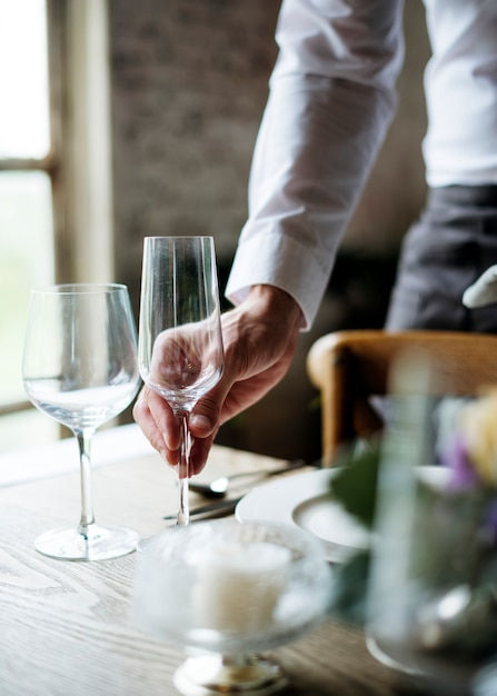 Restaurant staff setting table in restaurant for reception Premium Photo