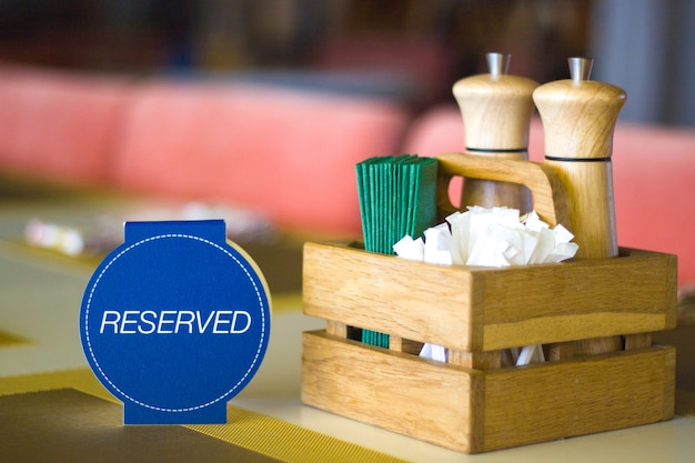 Restaurant table setting service for reception with reserved card Premium Photo