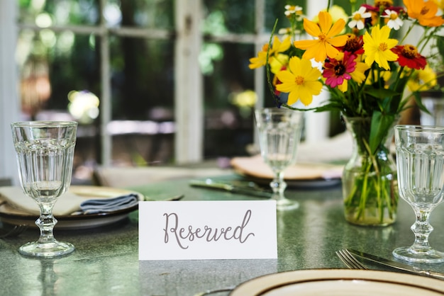 Restaurant table setting service with reserved card Premium Photo