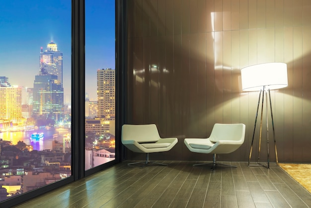 Resting room concept. empty sofa with lamp in room with night city view outside. Premium Photo