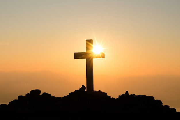 Resurrection concept: crucifixion of jesus christ cross at sunset Free Photo
