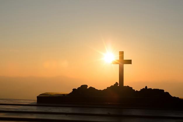 Resurrection concept: crucifixion of jesus christ cross at sunset Free Photo