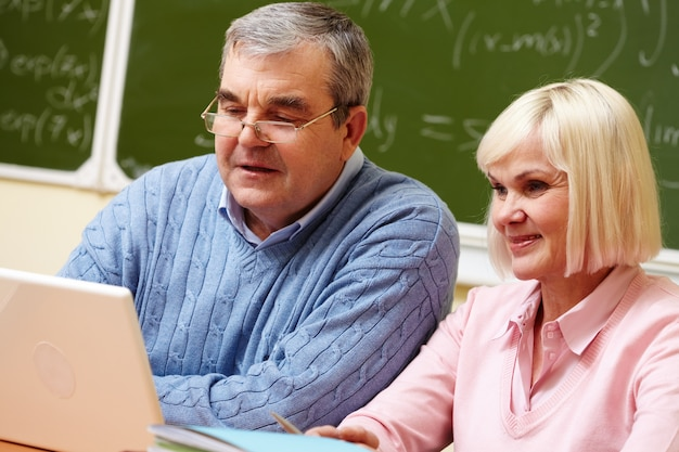 Retired couple studying at school Free Photo