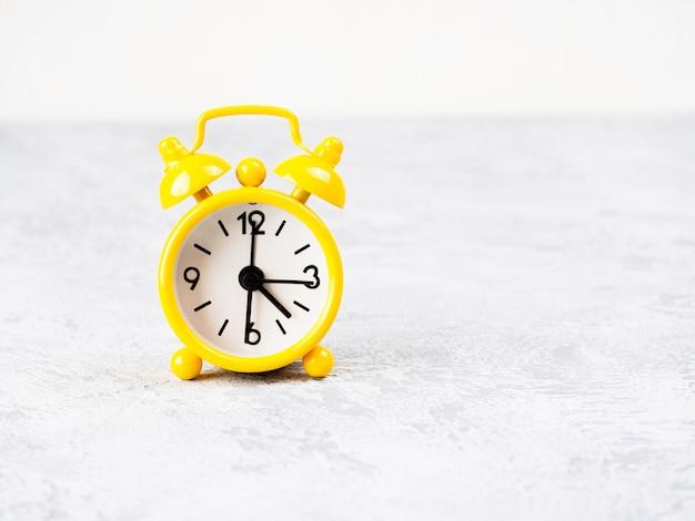 Retro alarm clockson table. photo in retro color image style Premium Photo