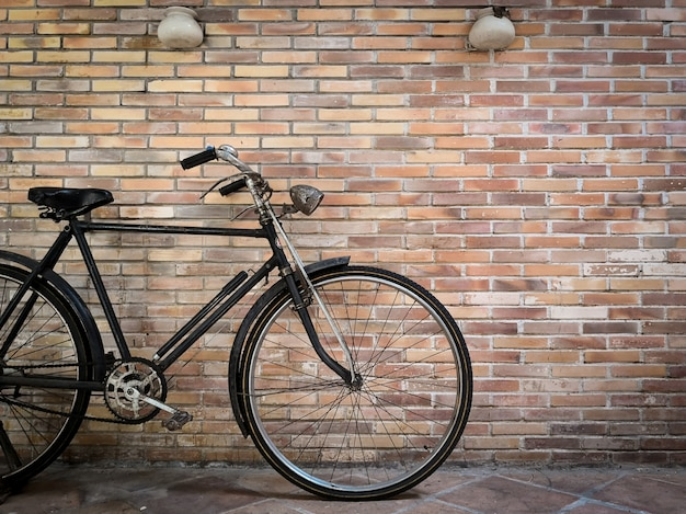 Retro bicycle in front of the old brick wall. Premium Photo