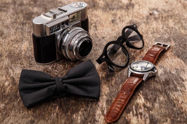 Retro camera, watch, bowtie and glasses Free Photo
