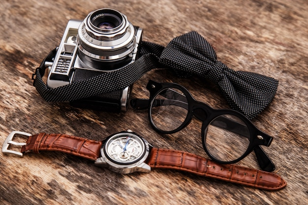 Retro camera, watch, bowtie and glasses Free Photo