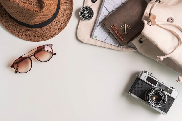 Retro camera with travel accessories and items on white background with copy space, travel concept Premium Photo