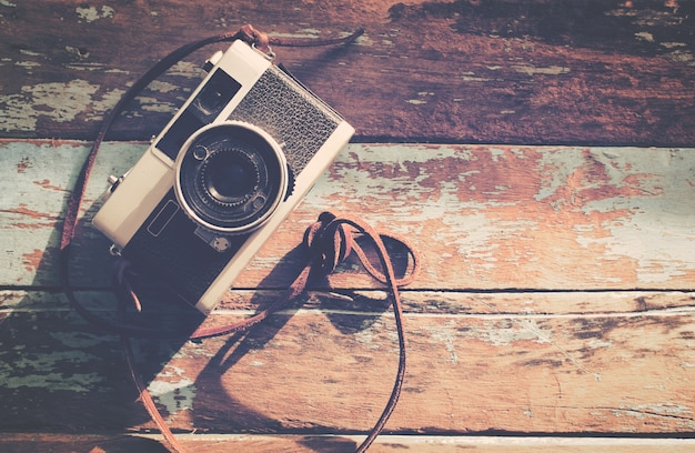 Grunge Camera Effect : Retro camera on wood table background vintage color tone