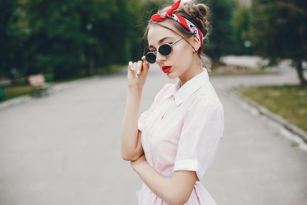 Retro girl in a park Free Photo