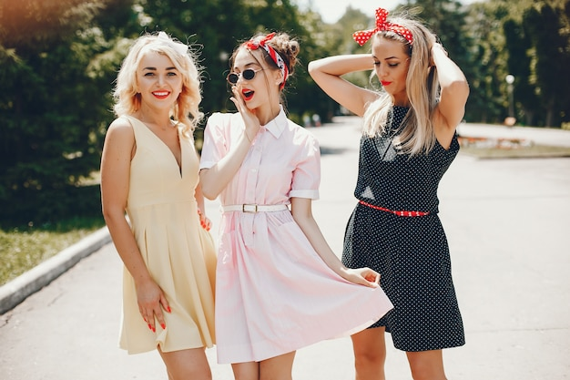 Retro girls in a park Free Photo