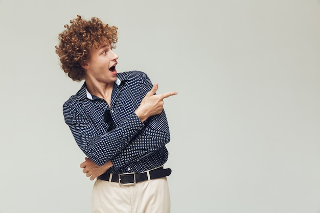 Retro man dressed in shirt standing and posing Free Photo