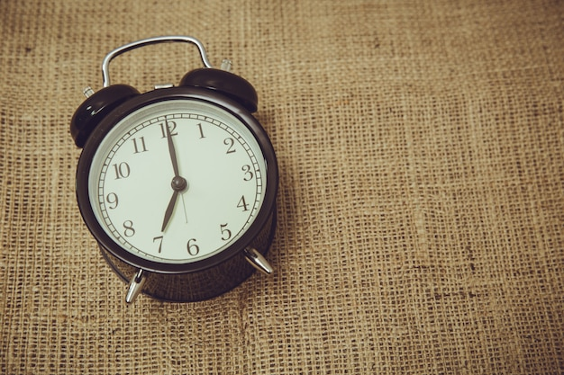 Retro old back bell clock time a Premium Photo