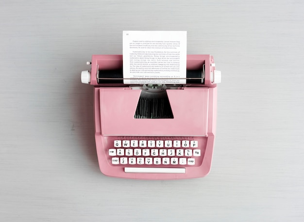 Retro pastel typewriter on grey surface Premium Photo