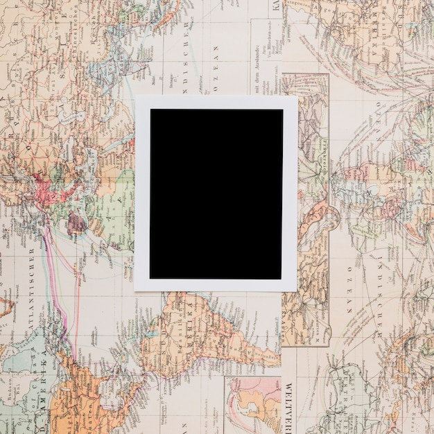 Retro photo frame on world map Free Photo