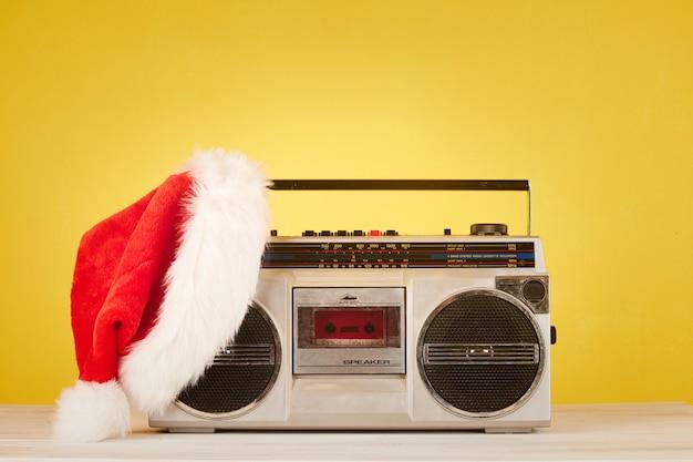 Retro radio cassette with christmas hat Premium Photo