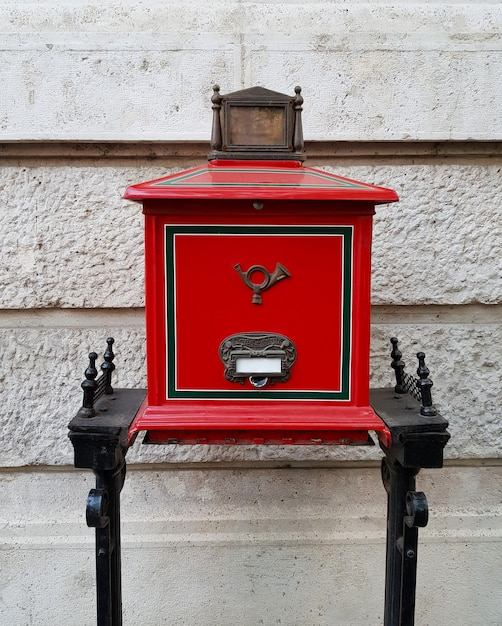 Retro red hungarian mailbox on street Premium Photo