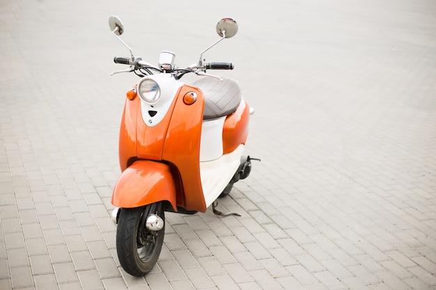 Retro scooter on the city streets Premium Photo