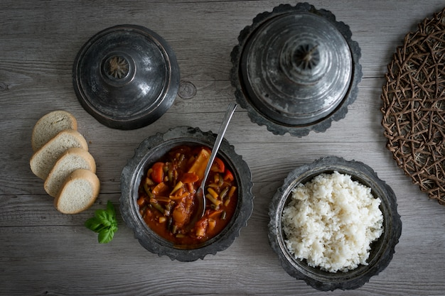Retro silver utensil and plates with food Premium Photo