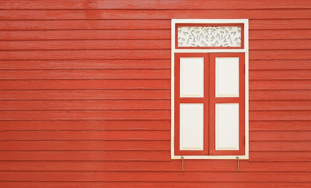 Retro style wall wood plank house with windows. Premium Photo
