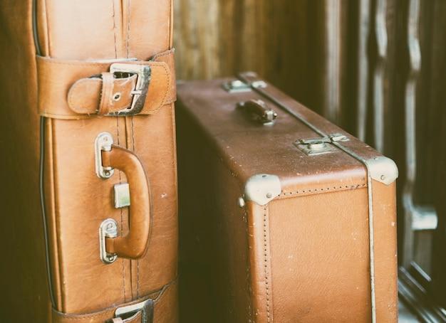 Retro suitcase near the door Premium Photo