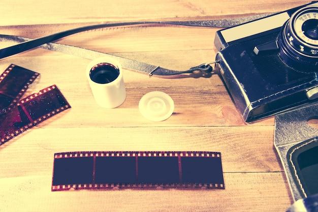 Retro vintage camera on wooden background. Free Photo