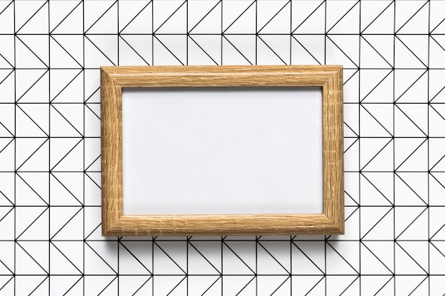 Retro wooden frame with pattern background Free Photo